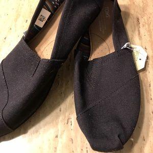 Women's black TOMS shoes